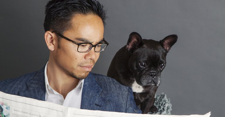 man and dog reading newspaper