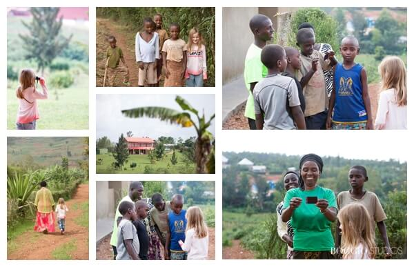 visiting Rwanda with children - showing polaroids to people in Rwanda