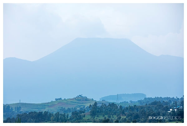 visiting Rwanda with children - Volcano in distance
