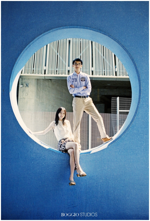 Couple sat in blue circle wall in London