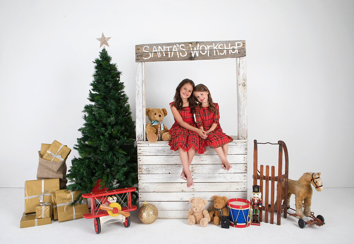 two girls in red dresses in Santa's Workshop