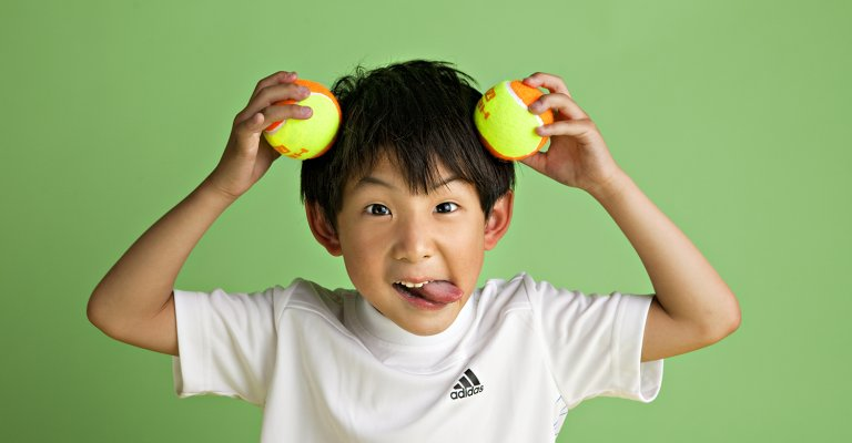 chinese boy with tennis balls