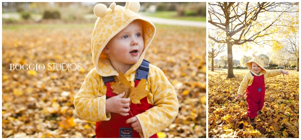 Little girl in bear outfit playing in autumn leaves