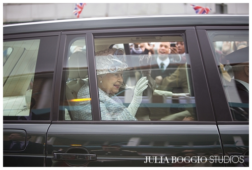 The Queen gives her famous royal wave to the crowds at St Marks Academy in Merton by Julia Boggio