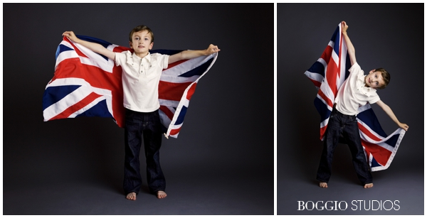 young boy playing with a union jack flag