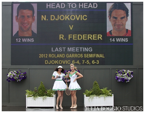 Our pin up girls pose with Roger Federer's photo at Wimbledon 2012