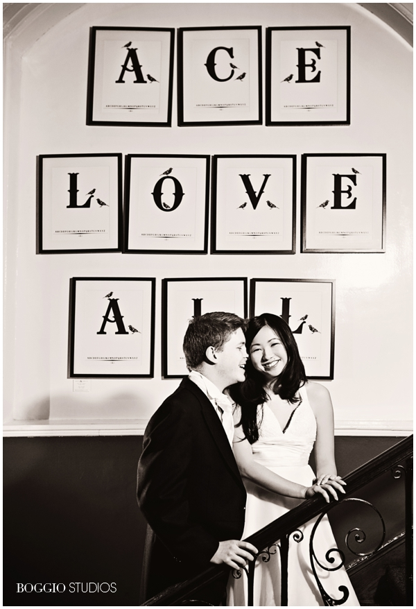 Bride & Groom standing on stairs under love sign