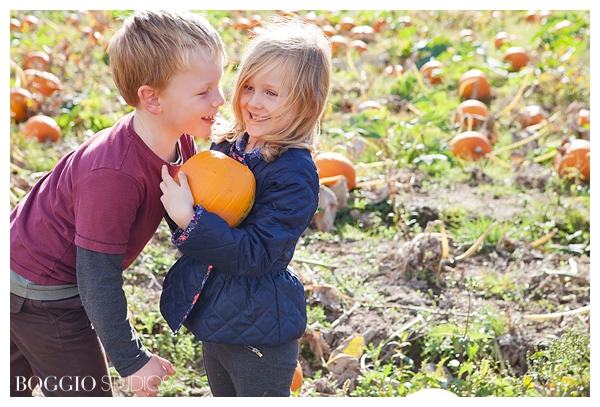 best friends playing in pumpkin patch, age 5